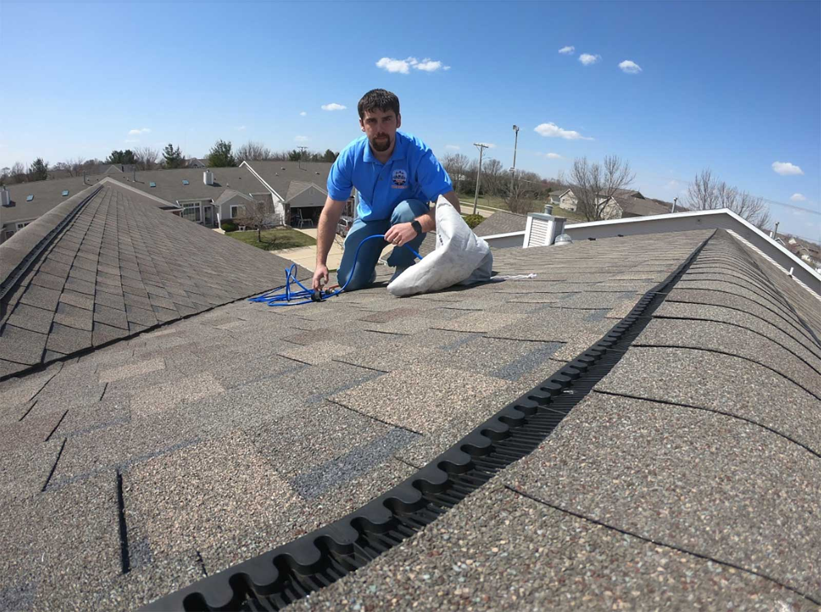 dryer vent squad technician on roof